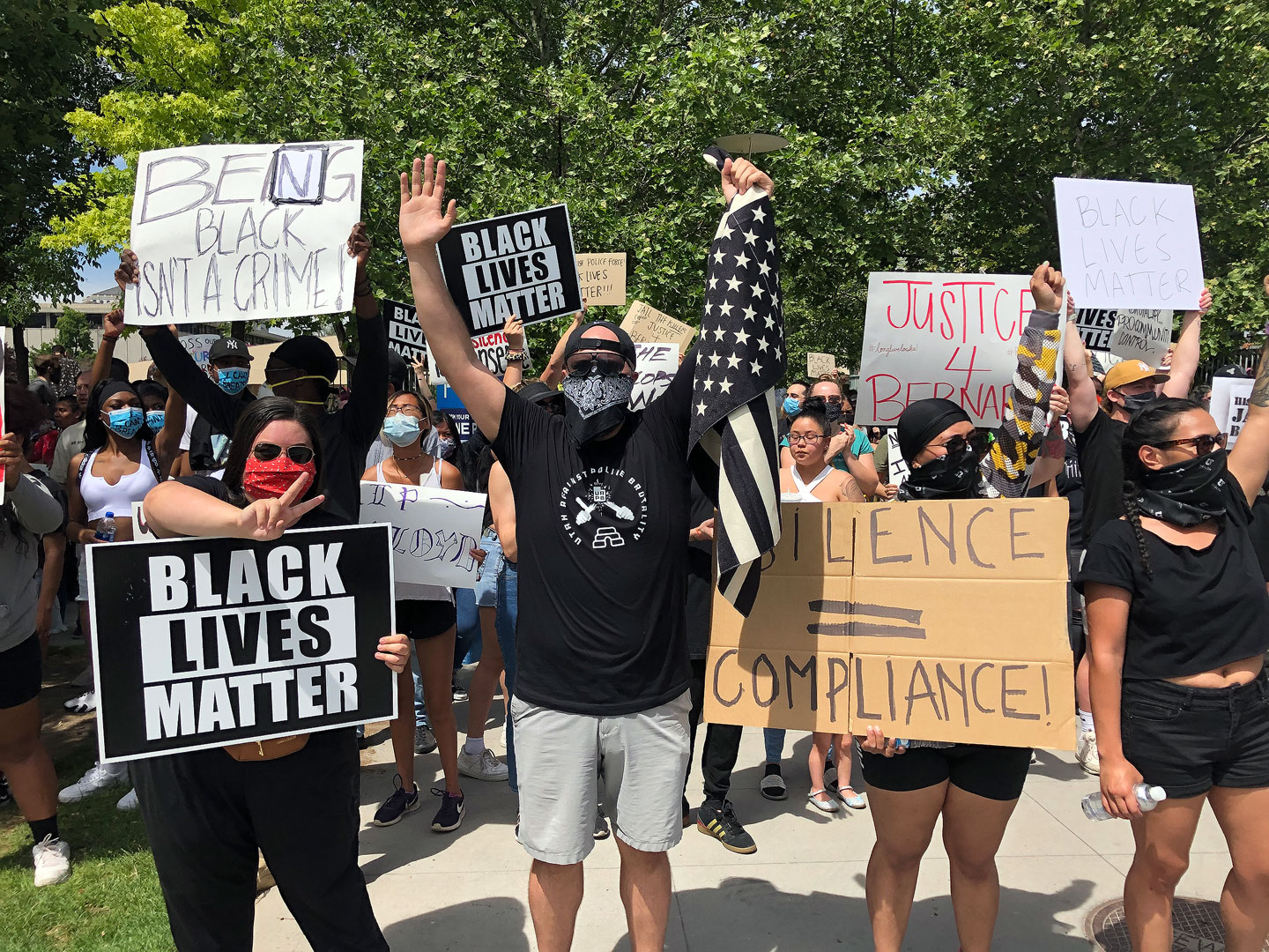 """Protesters shout """"Hands up, don't shoot"""""""