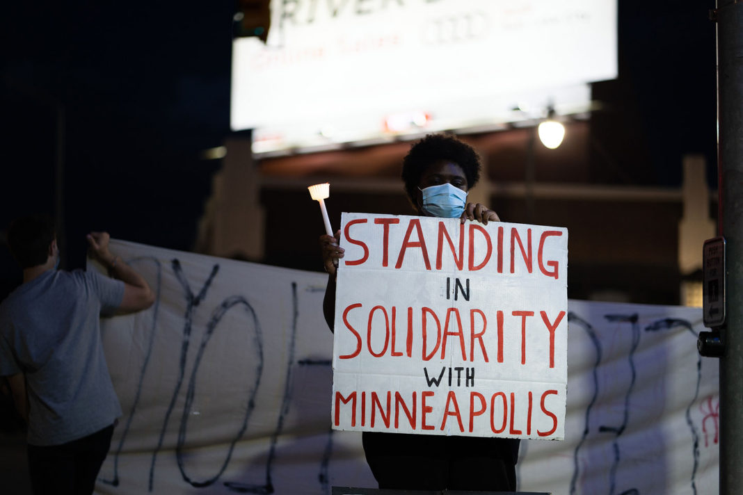 """Sign reads """"Standing in solidarity with Minneapolis"""""""