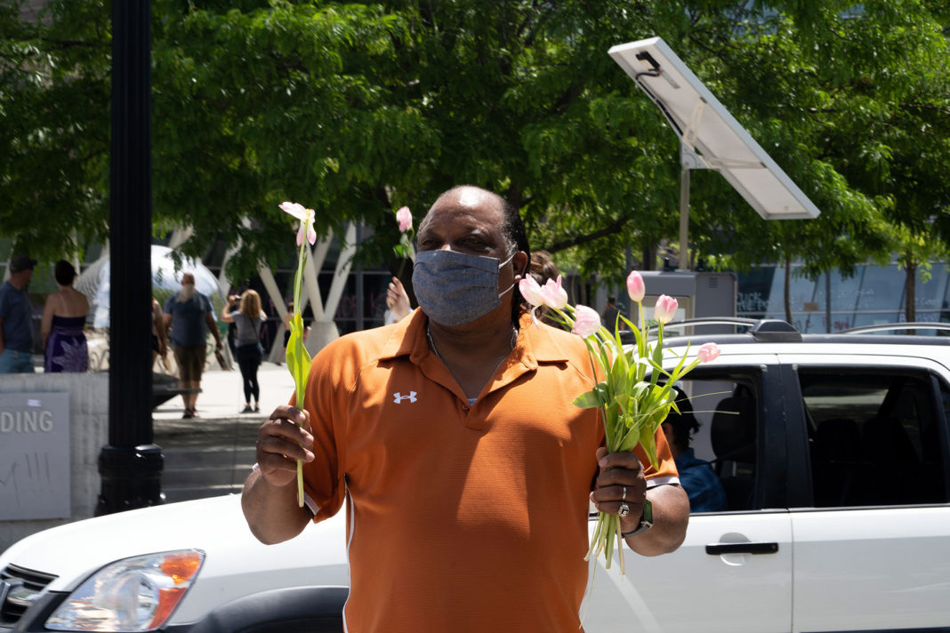Masked man with flowers