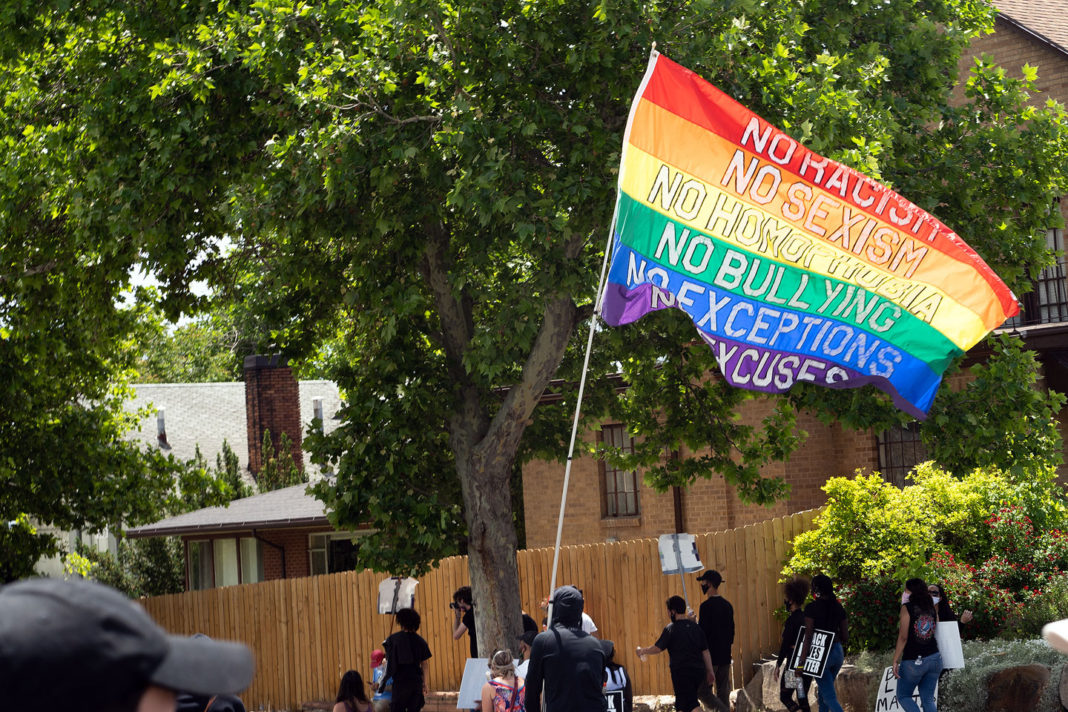 """Rainbow flag with """"no excuses"""""""