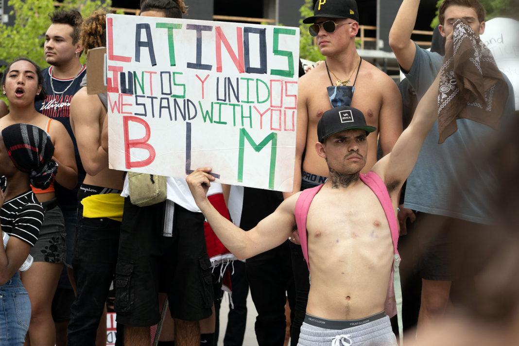 "Sign reads ""Latinos juntos y unidos we stand with you BLM"""