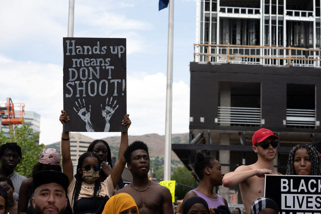 """Sign reads """"Hands up, don't shoot"""""""