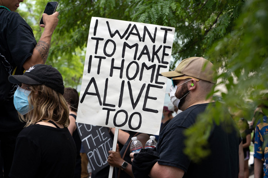 """Sign reads """"I want to make it home alive too"""""""