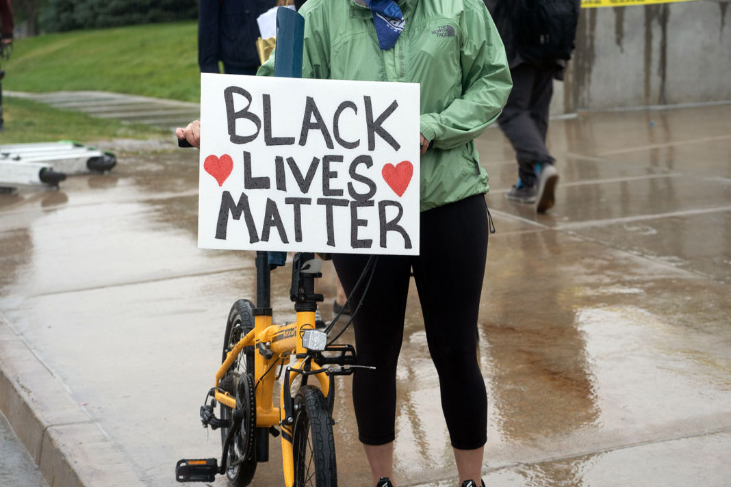 Black Lives Matter sign affixed to bicycle