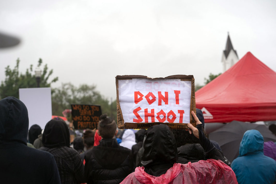 """Sign reads """"Dont shoot"""""""