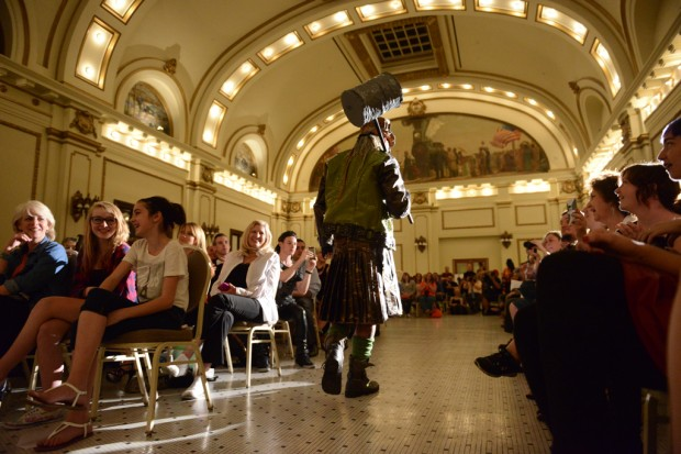 A model wearing a steampunk inspired outfit walks through the crowd at a fashion show put on by the SLCC Fashion Institute