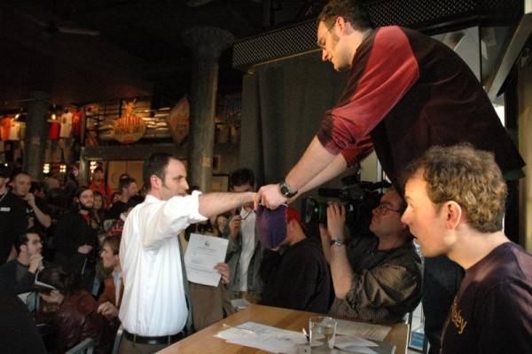 Boston Producer Ben Guaraldi holds out the hat as a team leader picks out a genre during the Boston 2005 Kickoff.