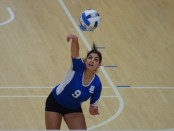 Mariana Pilon strikes the ball against the Cardinals