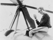 Amelia Earhart seated outside her cockpit in Los Angeles after completing the Transcontinental Flight in 1932.