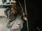 Alex Cross (Tyler Perry) hangs onto a piece of rebar after an explosion.