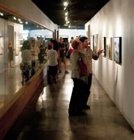 Vitsitors in hallway of V. Douglas Snow art exhibit