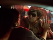 """The Hangover Part III"" still image featuring Ken Jeong, Bradley Cooper and Zach Galifianakis."