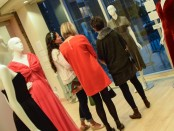 Fashion Show visitors admire dress