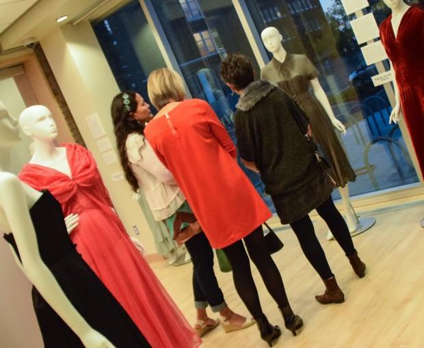 Fashion Show visitors admire dress
