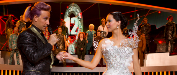 The film is once again caught between the realms of theatrics and realism, making for a moderate confusing time. Featured: Stanley Tucci (Left) reprising his role as Casear Flickerman, and Jennifer Lawrence (Right) reprising her role as Katniss Everdeen.