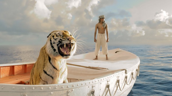 A still from Life of Pi featuring Suraj Sharma and the tiger.