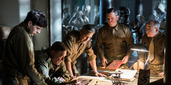 Still from The Monuments Men featuring Dimitri Leonidas, John Goodman, George Clooney, Matt Damon, and Bob Balaban.