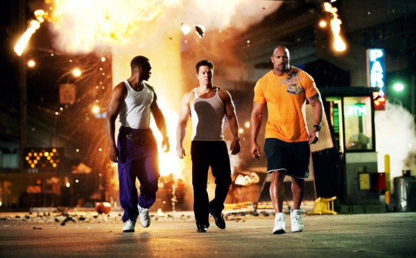 "Dwayne Johnson, right, Mark Wahlberg, center and Anthony Mackie in a scene from ""Pain & Gain"""
