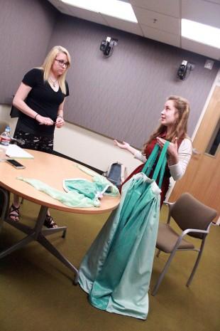 Sara Thompson holds Ariel dress