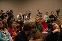 Media members gather