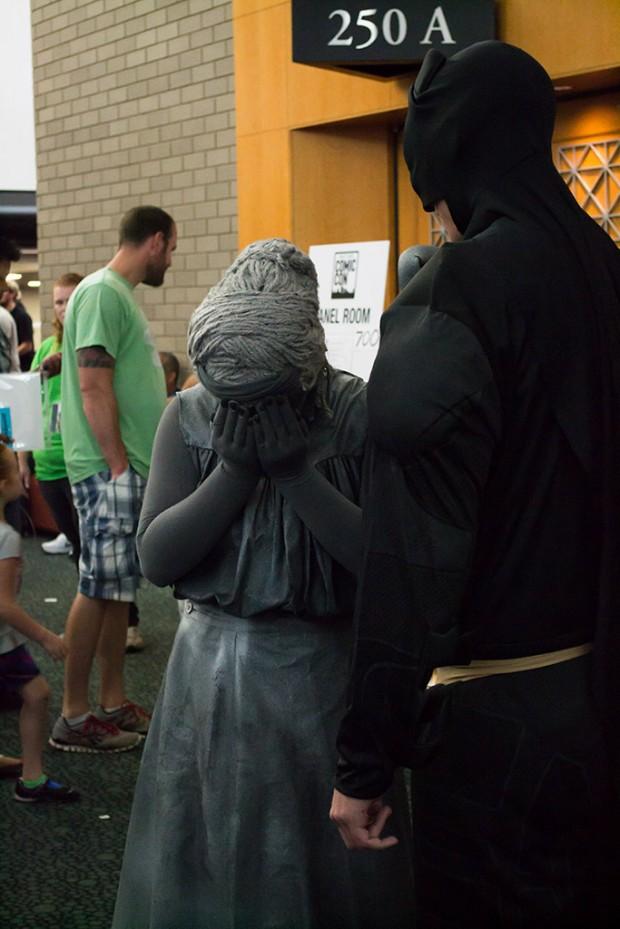The Dark Knight, right, and a gargoyle