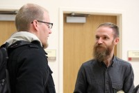 Adam Davies talks with a student