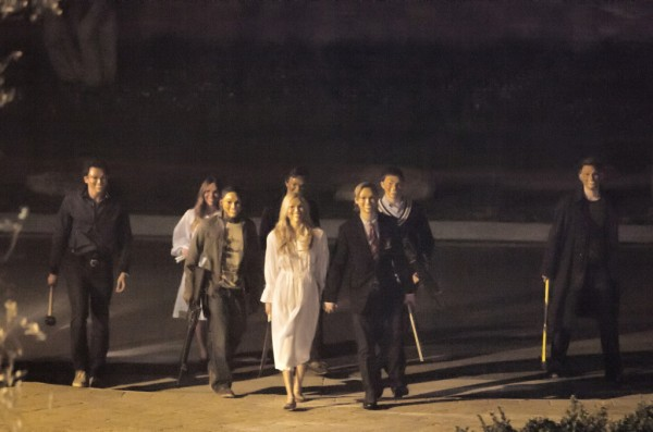 "The Polite Stranger and his gang approach the house in a scene from ""The Purge"""