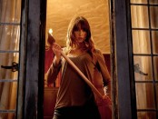 Still from You're Next featuring Sharni Vinson.