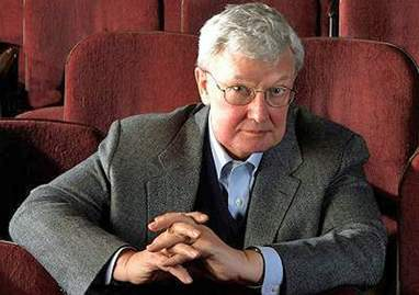 An image of Roger Ebert sitting in theatre chairs