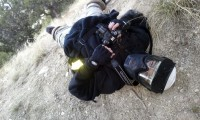 Photographer on the ground after getting hit by gunfire