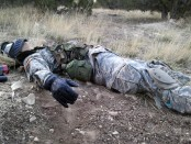 A cadet plays dead during the STX lane
