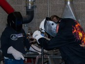 Automotive students welding