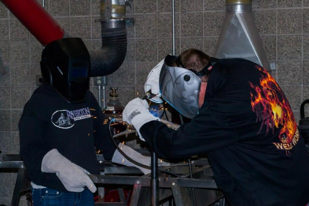 Shadia Trussel and Brandon J. Ward practicing welding