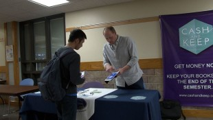 John Fenton, right, helps a student