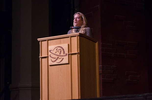 Cheryl Strayed speaks from a podium at The Grand Theatre