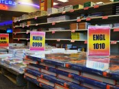 Thousands of textbooks lined along bookshelves