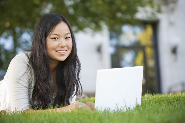 Girl outside with a laptop