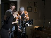 Students set up the camera on the set