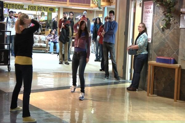 Onlookers watch the flash mob