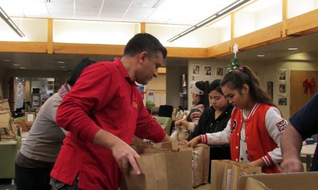 Volunteers fill snack sacks