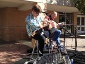 Jeremiah Maxey plays guitar