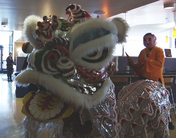 A lion spreads good luck at the Taste of Asia event at the Taylorsville Redwood Student Center.
