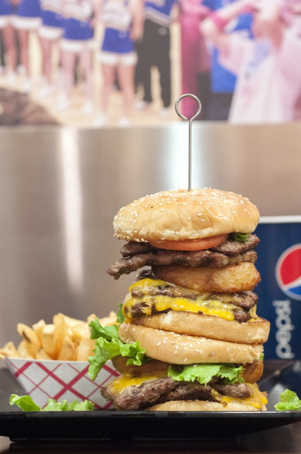 The Champions Grill serves a burger that stands taller than the Pepsi cup for the Chanllenge.