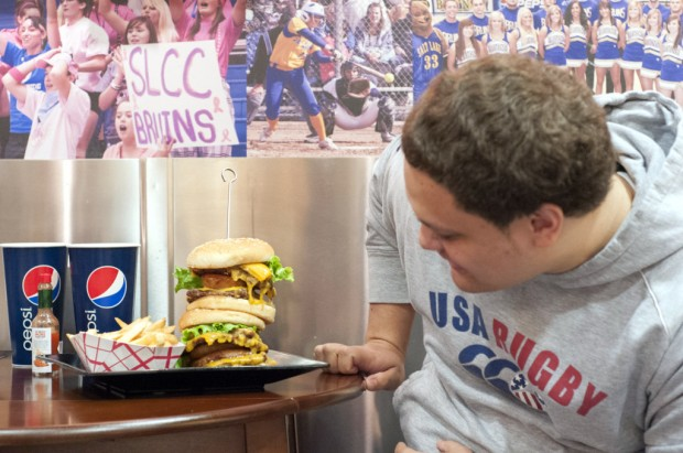 David looks at the giant burger in amazement before beginning the challenge in the Champions Grill.
