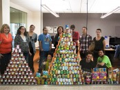 The Globe staff with donations from 2013 MCC Food Drive
