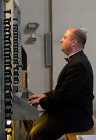 SLCC Alumnus Christopher Roy playing the organ