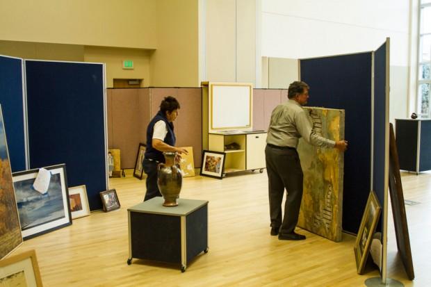 Art Committee Members Gordon Storrs and Maria Bardini setting up.