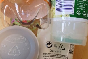 A close up of plastic products showing the recycling codes.