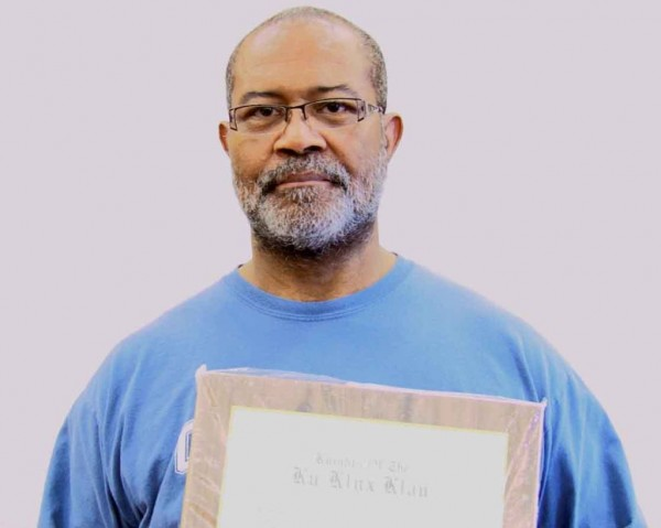 Ron Stallworth holds his KKK membership.