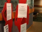Red silhouettes represent victims of domestic violence.